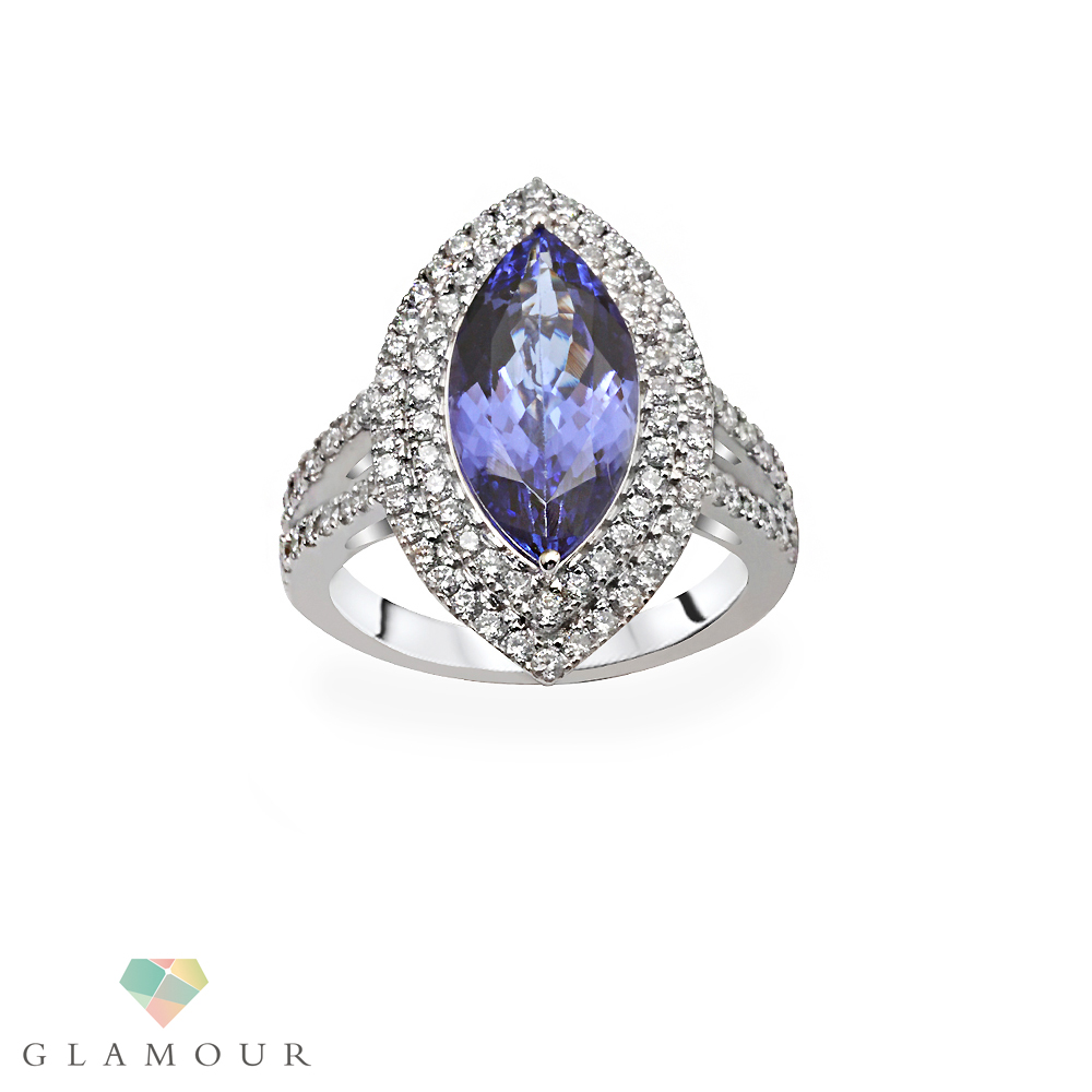 This Glamour's & dazzling marquise ring makes you stand out of the crowd. Crafted from 18 k white gold featuring Marquise shape Tanzanite & round cut diamonds.